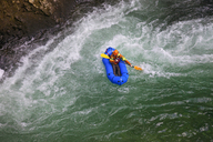 Evan Howard, an avid Explorer and adventurer, navigates a white water section of the Chehalis River on a packraft. - AURF05078