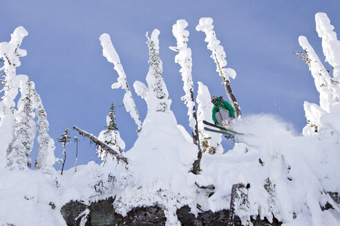 Male Skier Jumping Off A Cliff In The East Rim At Whitefish Mountain Resort - AURF05294