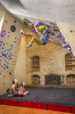 Multi-ethnic Family Playing On Climbing Gym In Their House - AURF05324
