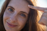 Portrait of smiling young woman with freckles - AFVF01567