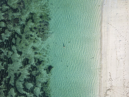 Indonesia, Bali, Melasti, Aerial view of Karma Kandara beach, one woman in water - KNTF01664