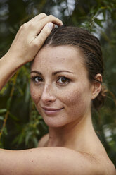 Portrait of freckled young woman in nature - PNEF00901