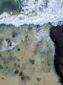 Indonesia, Bali, Aerial view of Dreamland beach, three surfers from above - KNTF01737