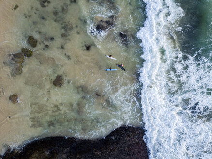 Indonesia, Bali, Aerial view of Dreamland beach, three surfers from above - KNTF01740