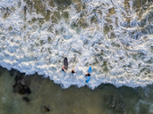 Indonesia, Bali, Aerial view of Dreamland beach, three surfers from above - KNTF01743