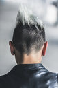 Rear view of punk woman with mohawk haircut - GIOF04410