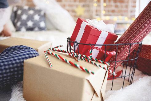 Close-up of Christmas presents in bedroom - ABIF01044