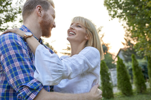 Happy couple hugging outdoors - ZEDF01559
