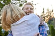 Happy couple hugging outdoors - ZEDF01562
