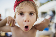 Portrait of little boy pulling funny faces - AZOF00056