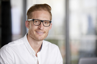 Portrait of smiling redheaded businessman wearing glasses - RBF06762