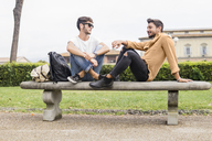 Young gay couple relaxing on bench - FBAF00051