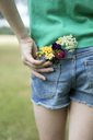 Flowers in pocket of girl's jeans shorts - PSTF00256