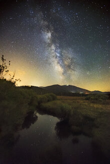 The Milky way shines in the night sky over Truckee's Martis Valley and Northstar's Mt. pluto - AURF05664