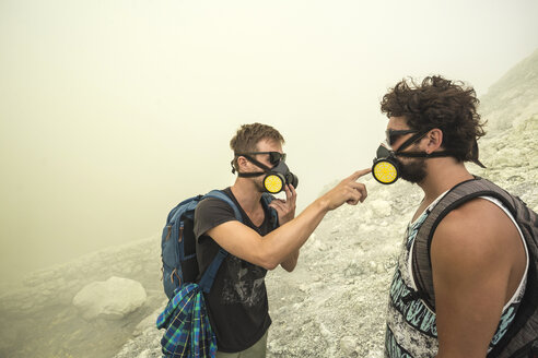 Two Male Hikers checking their air filters In Volcano Kawah Ijen, Java, Indonesia - AURF05688
