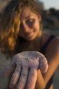 Woman In The Beach Showing Small Crab On Sand Covered Hand - AURF05838