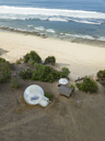 Indonesia, Bali, Aerial view of Nyang Nyang beach, Bubble tent house at the beach - KNTF01803