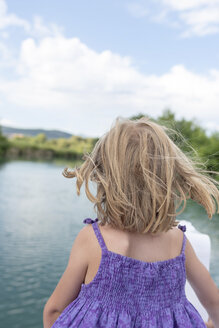 Rear view of girl on a boat trip - PSIF00094