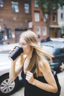 Young woman drinking cup of coffee in NYC - GIOF04503