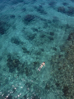 Indonesia, Bali, Aerial view of Blue Lagoon, snorkeler - KNTF01811