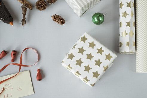 Writing Christmas cards and wrapping Christmas presents - MOMF00500