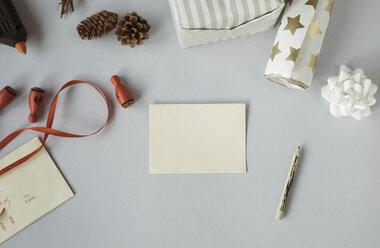 Writing Christmas cards and wrapping Christmas presents - MOMF00503