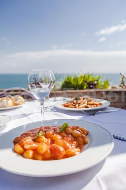 Italy, Atrani, plate of gnocchi with tomato sauce - FLMF00077
