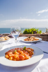 Italy, Atrani, plate of gnocchi with tomato sauce - FLMF00077