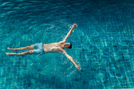 High angle view of man swimming in pool at resort - CAVF48778