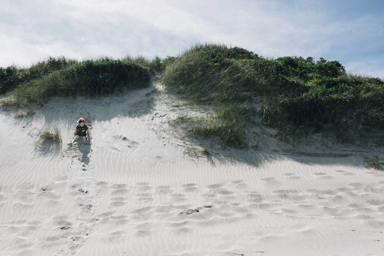 Boy playing in sand at beach during summer - CAVF48805 - Cavan Images/Westend61