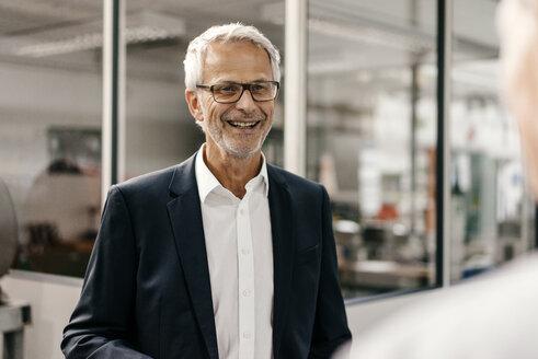 Portrait of a successful entrepreneur in his company - KNSF04824