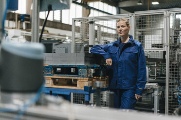 Young woman working as a skilled worker in a high tech company, portrait - KNSF04857