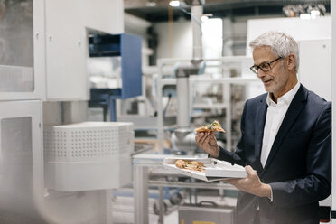 Manager in high tech company, eating pizza - KNSF04863