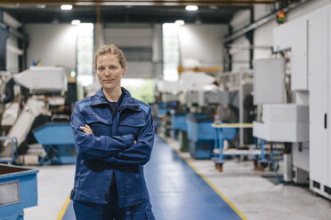 Young woman working as a skilled worker in a high tech company, portrait - KNSF04947
