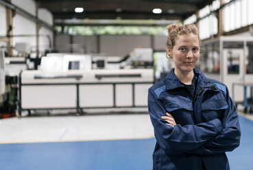 Young woman working as a skilled worker in a high tech company, portrait - KNSF04986