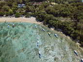 Indonesia, Bali, Aerial view of Padangbai, bay, beach, banca boats - KNTF01855