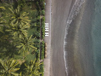 Indonesia, Bali, Aerial view of beach with empty sun loungers - KNTF01873