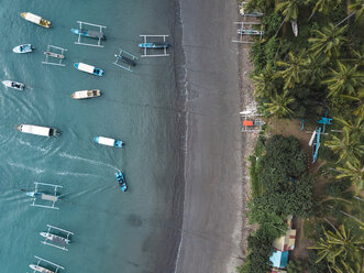 Indonesia, Bali, Aerial view of banca boats and beach - KNTF01876