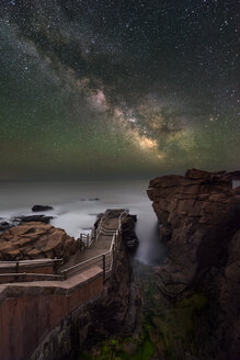 Scenery with Milky Way, footpath and cliffs on coastline at Thunder Hole in Acadia National Park - AURF06410