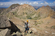 Man Descending From The Summit Of Windom Peak - AURF06606