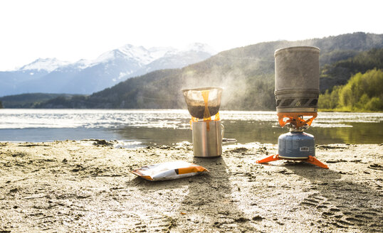 Coffee being prepared on camp stove on shore of Green Lake, Whistler, British Columbia, Canada - AURF06743
