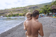 Father and son at the beach,Bali,Indonesia - AURF06899