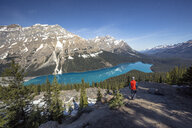 Hiker looking at view of Peyto Lake and Canadian Rockies in Banff National Park, Alberta, Canada - AURF06914