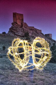 Light painting in front of Castle of Zafra, Campillo de Duenas, Guadalajara, Castilla La Mancha, Spain - AURF06932