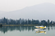 Float plane moored on Green Lake, Whistler, British Columbia, Canada - AURF06998