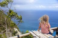 Little girl admiring ocean coastline of Nusa Penida island, Bali, Indonesia - AURF07139