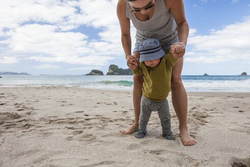 Mother and son playing on beach, Hahei, Coromandel, New Zealand - AURF07182