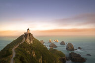 New Zealand, South Island, Otago,  Nugget Point Lighthouse at sunset - MKFF00403