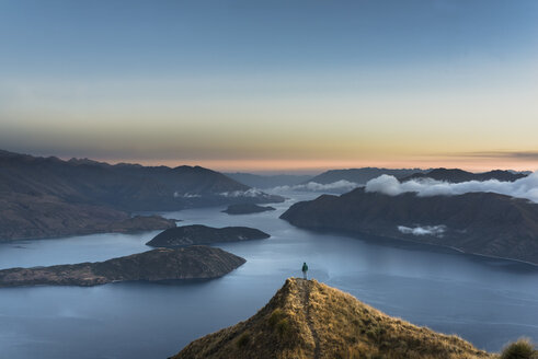 New Zealand, South Island, Wanaka, Otago, Woman on Coromandel peak at sunrise - MKFF00409