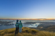 New Zealand, South Island, Wanaka, Otago, Couple on Coromandel peak at sunrise - MKFF00412